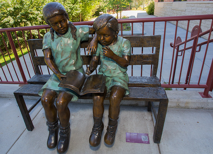 Kids on a Bench (Photo by Hayes Novich Photo)